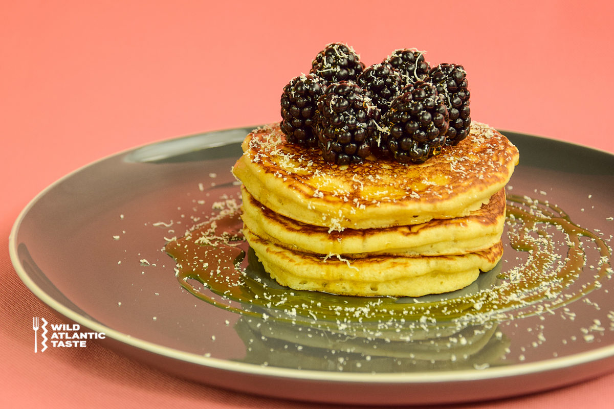 American style pancakes with blackberries and maple syrup