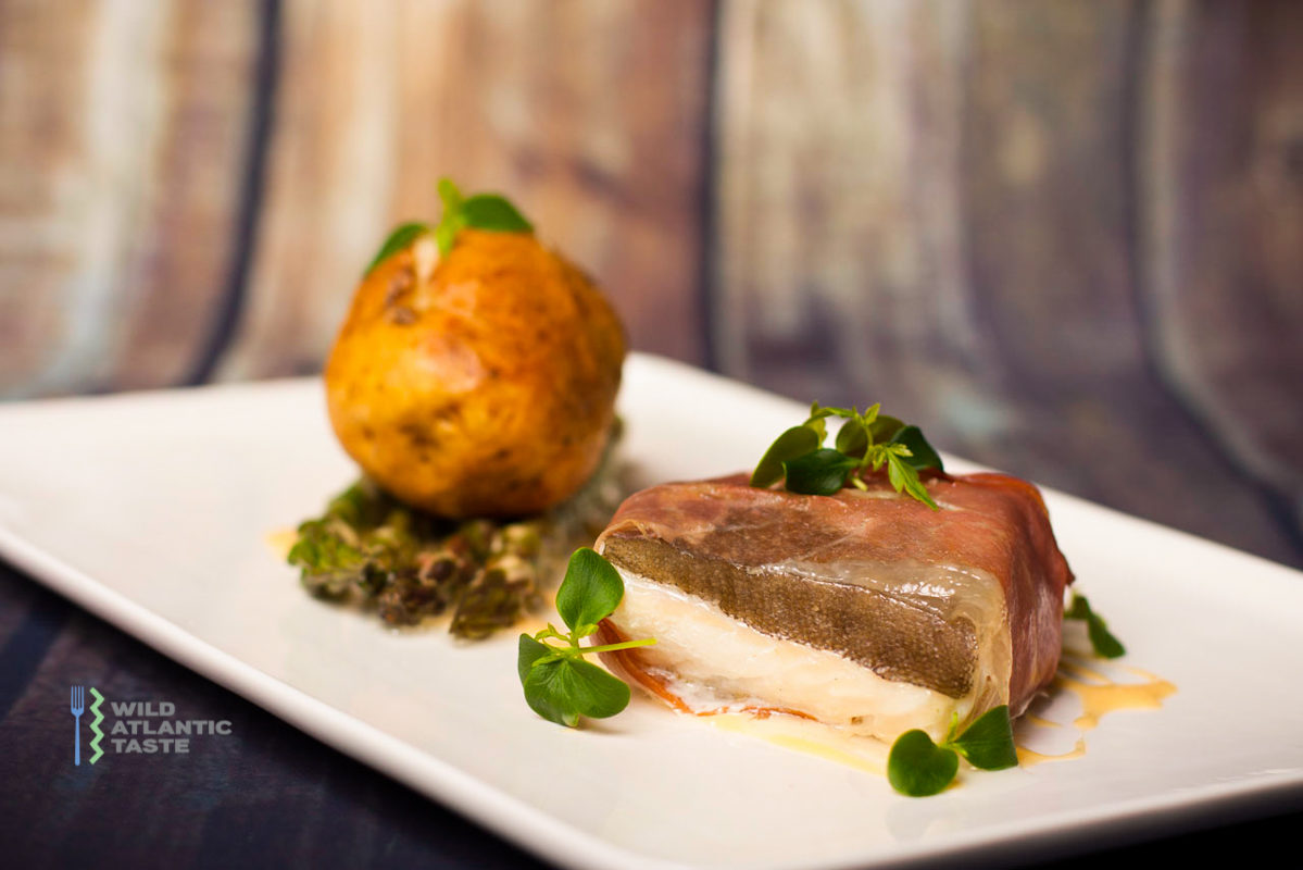 Baked Atlantic cod with baked potato and asparagus