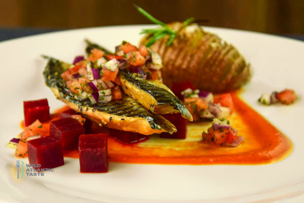 Baked mackerel fillets with hasselback potato and tomato salsa