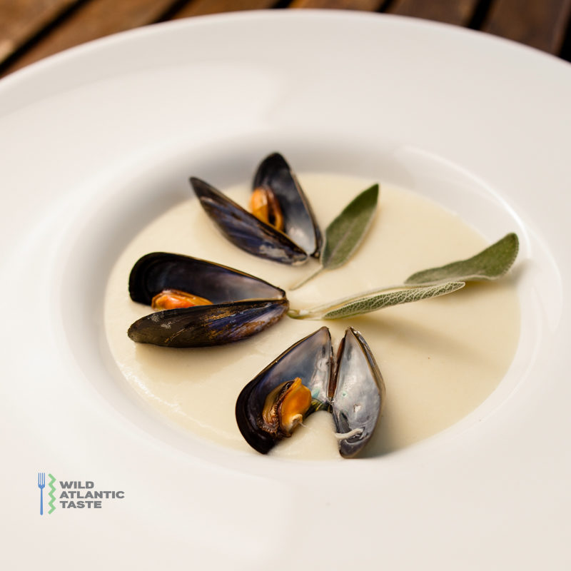 Garlic and white wine soup with mussels and sage