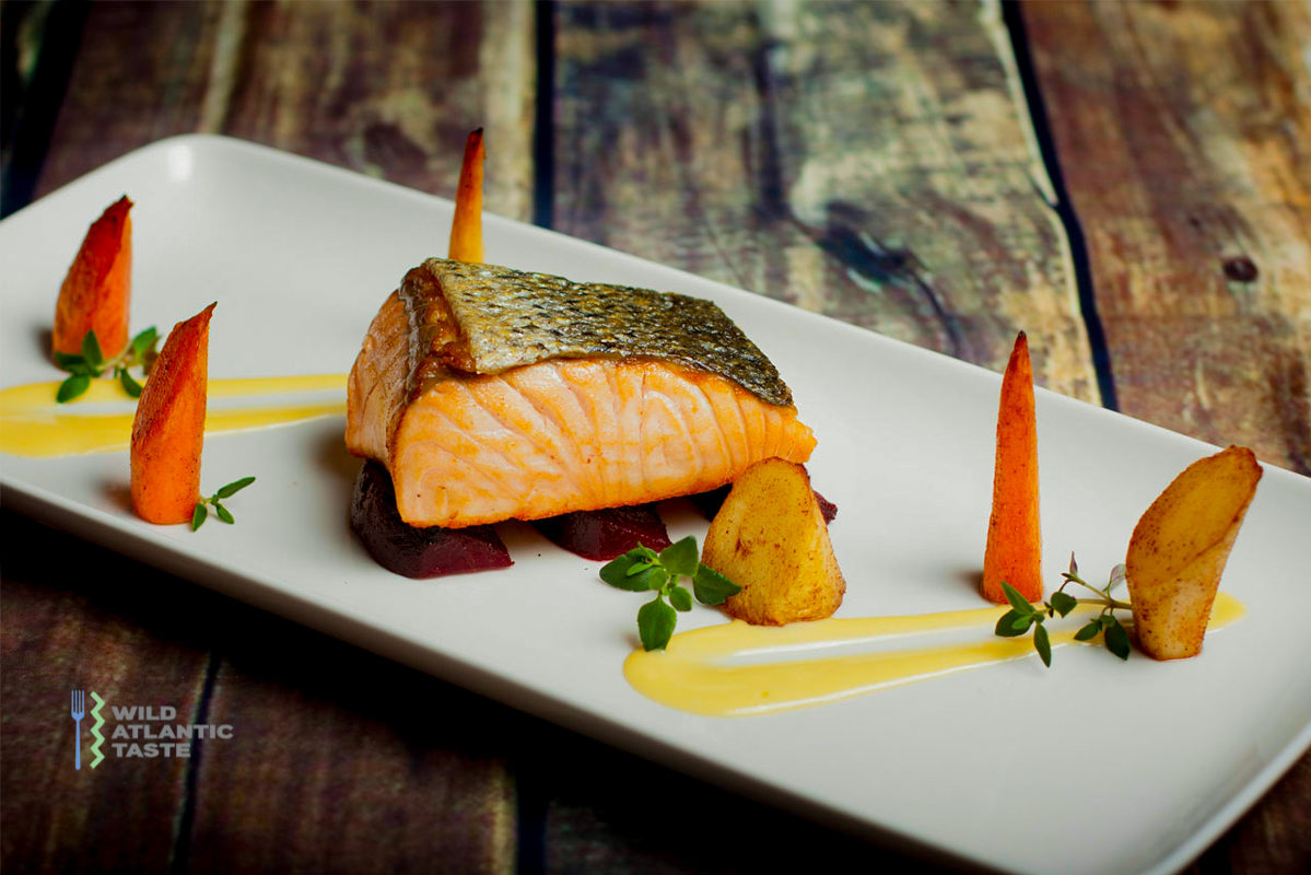 Roast Atlantic salmon with root vegetables and beurre blanc sauce