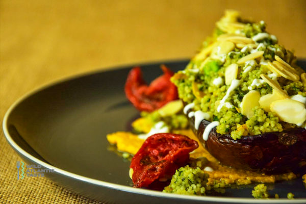 Roast aubergine with couscous and sweet potato hummus