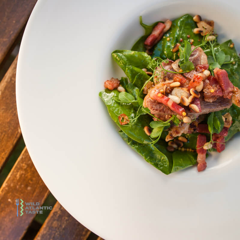 Spinach salad with crispy duck breast