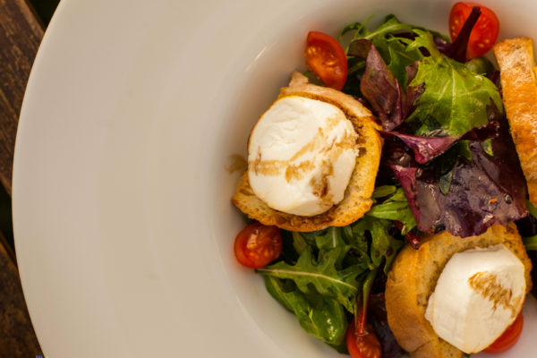 Summer salad with goat cheese bruschetta