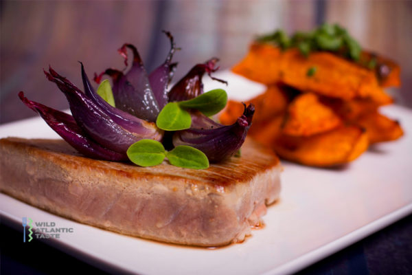 Tuna steaks with sweet potato and red onion wedges