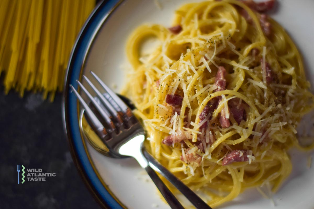 Discover how to make classic spaghetti carbonara. This cheesy pasta dish is an Italian favourite but very often is one of the most popular dishes on the Wild Atlantic Way. Just a handful of ingredients put it together properly will bring all the magic to the table.