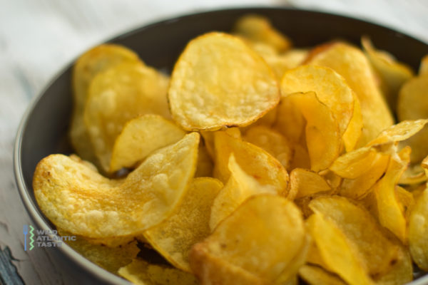 Homemade Potato Chips is fun and easy. At home, we don't cook chips very often, so when we do, we want the real deal. So let us tell you how to make the perfect homemade potato chips – if you're going to do it, do it right.