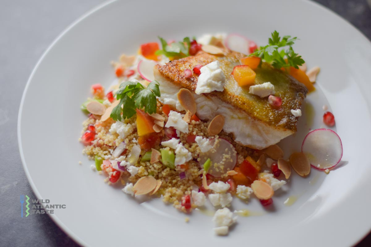Pan fried cod on the bed of couscous salad is a meal that's light and bright but still satisfying. Beautiful fillets are pan-seared and placed atop a bed of couscous studded seasonal vegetables. You'll want to keep this recipe in your back pocket because it's simple, versatile, and easy to enjoy during summer seasons.